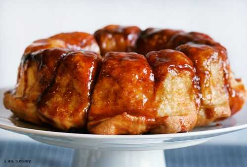 Monkey Bread on Cake Stand and Glaze Showing on all Edges