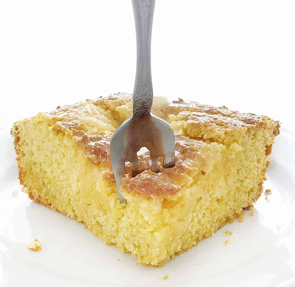 Sweet Cornbread Recipe, one piece with a fork taking a bite
