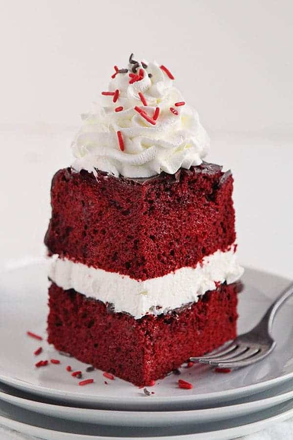 Red Velvet Cake Covered in Rich Chocolate Ganache and Topped with Peppermint Whipped Cream #cake #Christmas