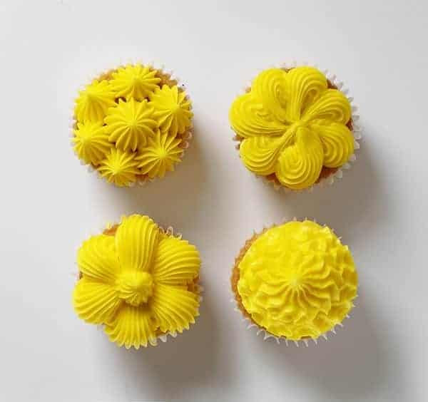 four cupcake decorating techniques using a large french star tip #cucpakes #cupcakedecorating #pipingtutorial