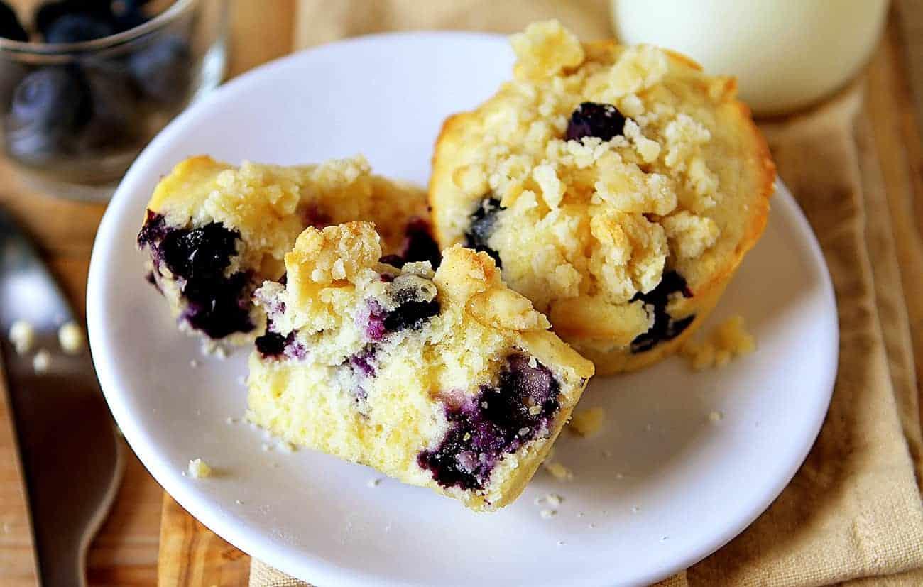 Broken Blueberry Pie Muffins on a White Plate