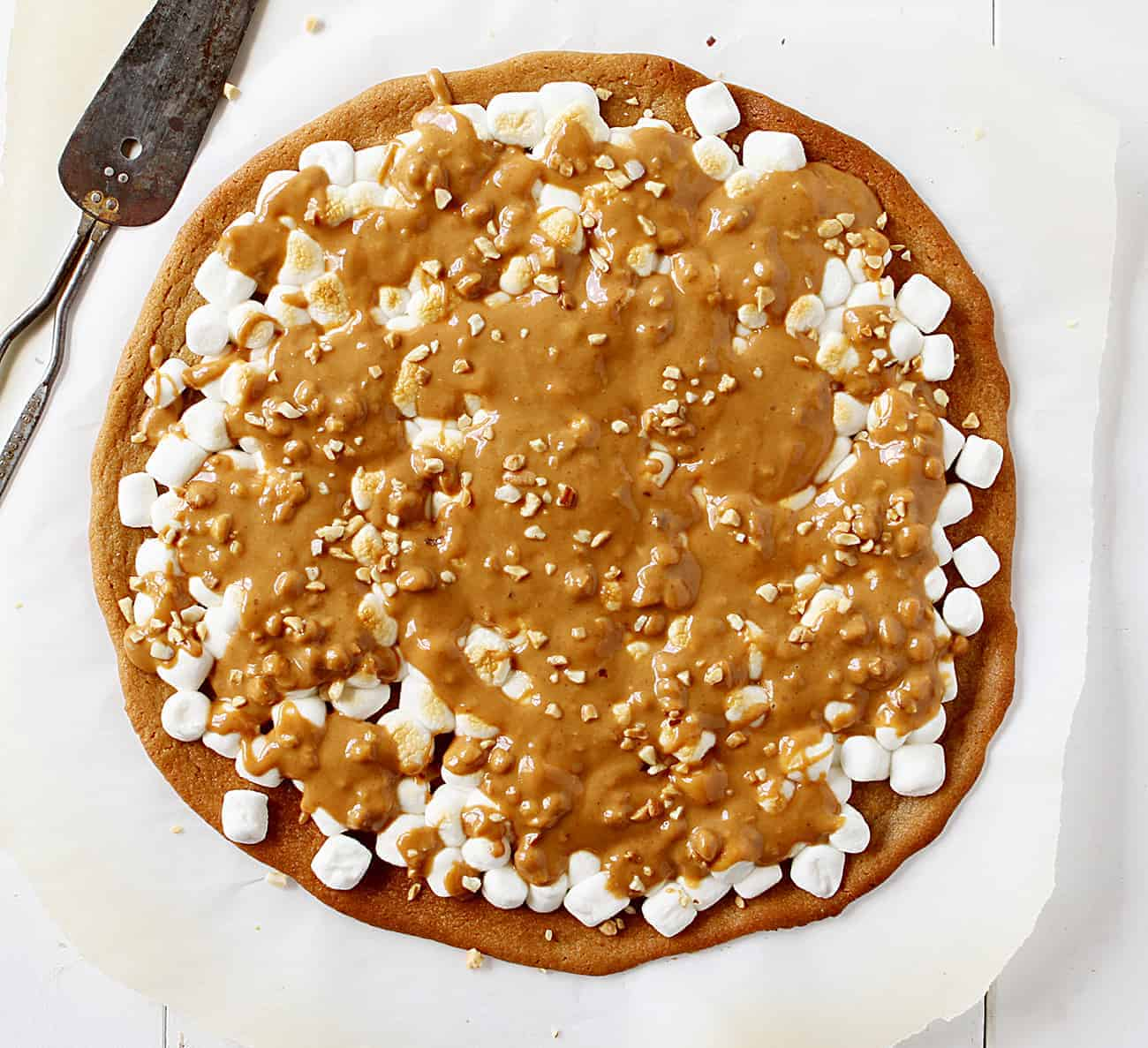 Overhead of Peanut Butter Marshmallow Dessert Pizza on Parchment Paper