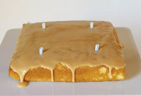 Caramel cake with straws to support