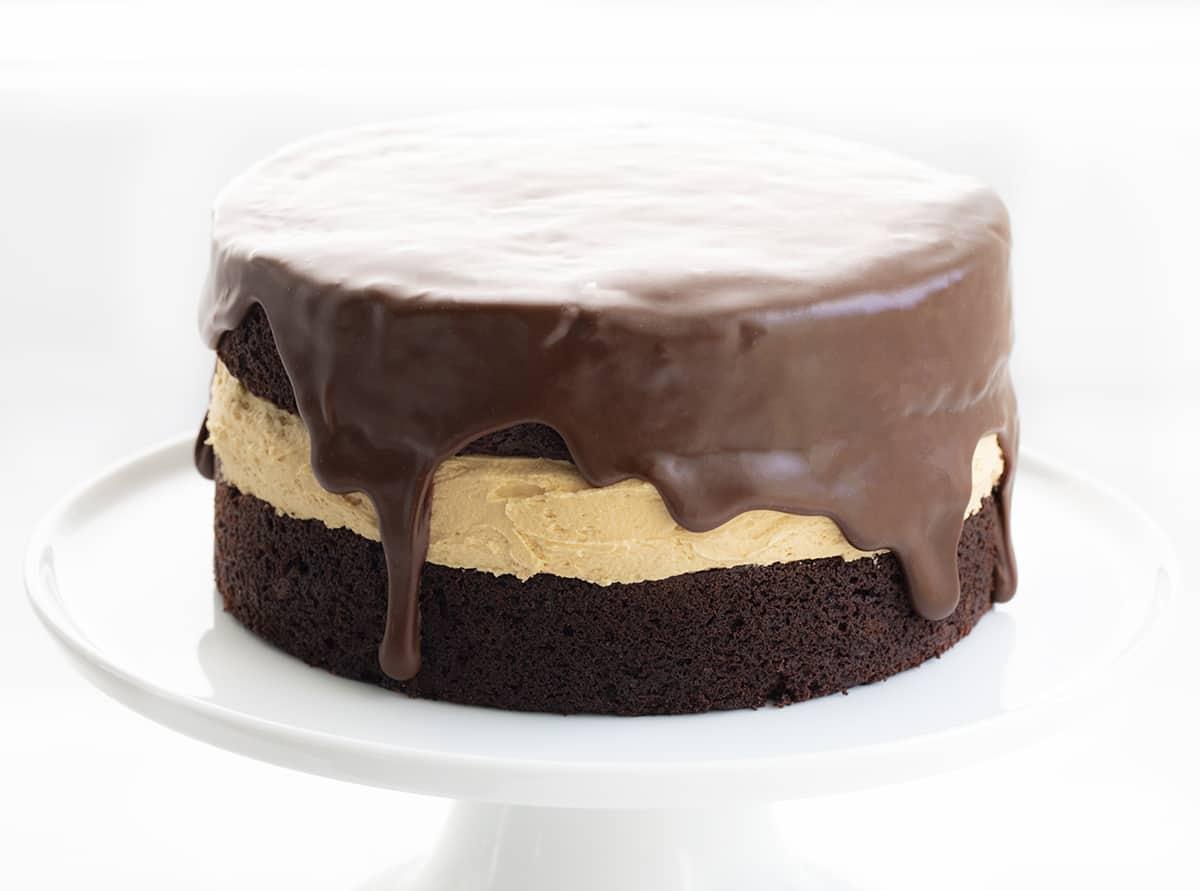 Biscoff Buckeye Cake on White Cake Stand