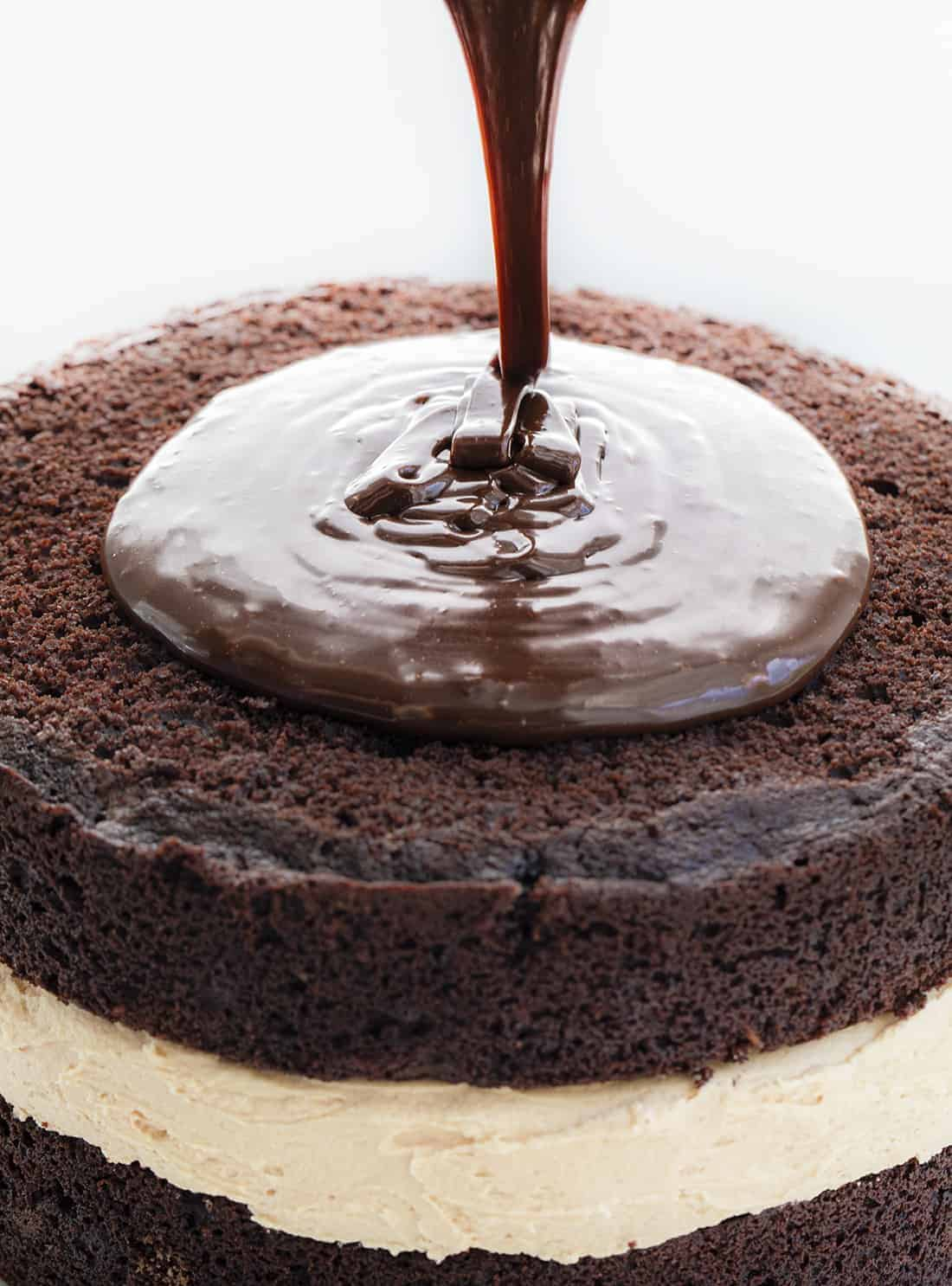 Adding Ganache to Biscoff Buckeye Cake
