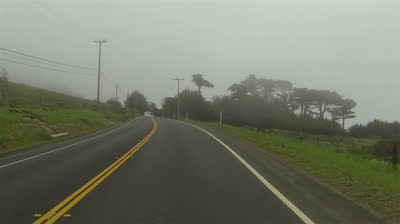 stock-footage-driving-dense-spotty-fog-rural-road-california-point-of-view-vehicle-on-a-foggy-stormy-rural-road