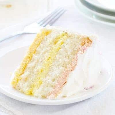Spring Cake! Raspberry, Lemon and Orange Cheesecake in a Moist White Cake!