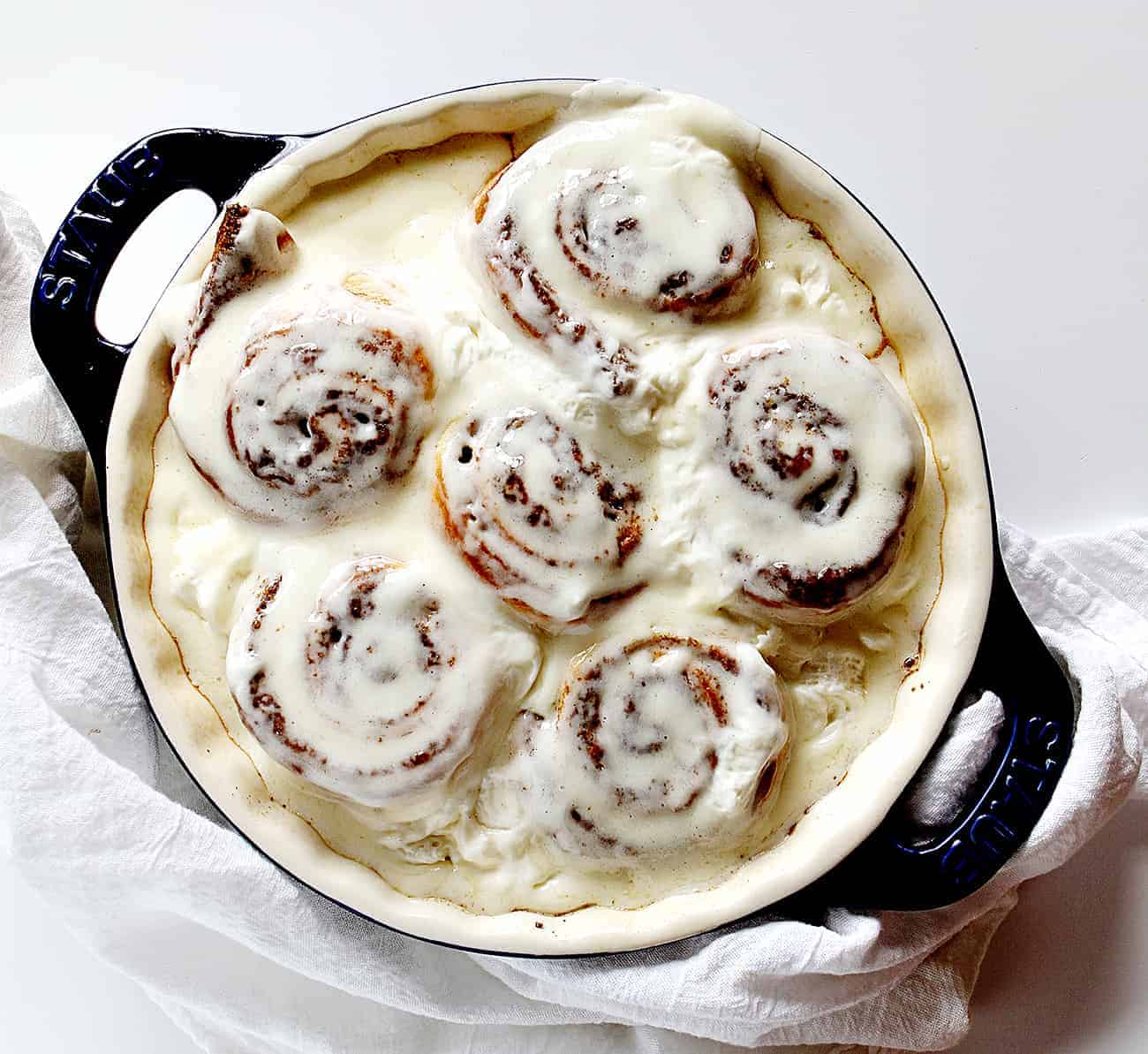 Baked Pumpkin Cinnamon Rolls with whipped cream cheese frosting