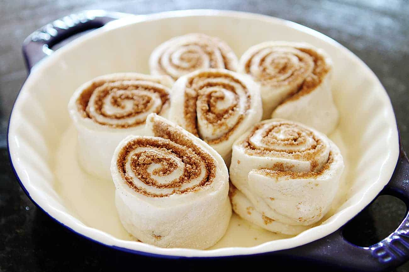 Plate of pumpkin cinnamon rolls ready to be baked