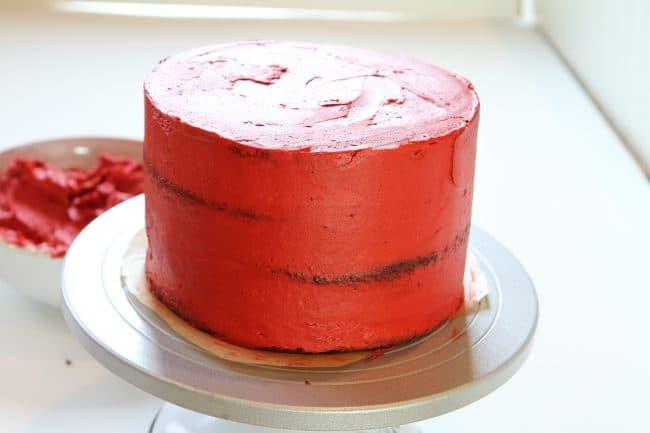 Crumb Coat of red buttercream
