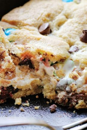 This decadent Skillet Cookie takes Ooey Gooey to a new level!