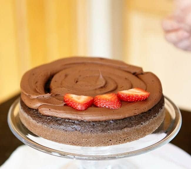 How to add strawberries to a layer cake.