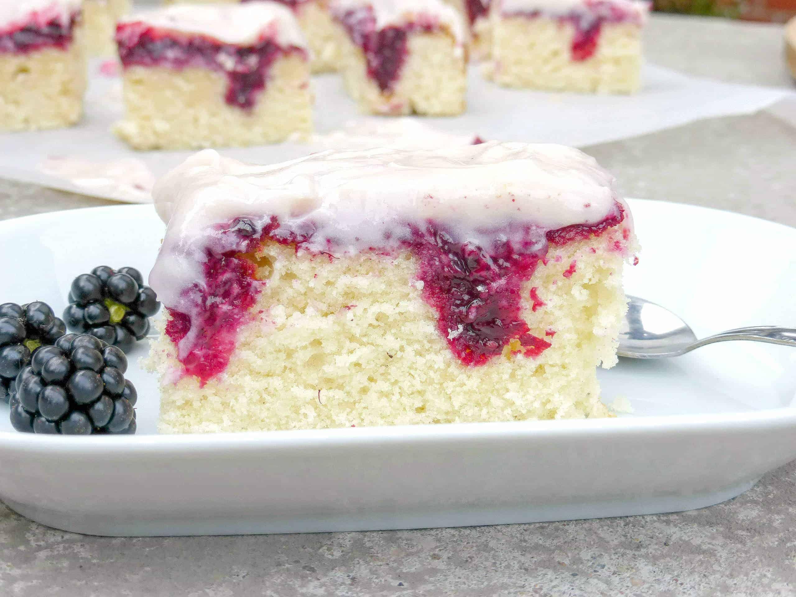 Blackberry and White Chocolate Poke Cake - i am baker