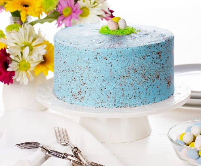 See my easy tutorial on how to get SPECKLED frosting!