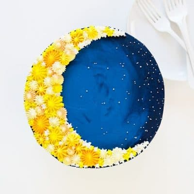 Overhead image of a cake decorated to look like a crescent moon!