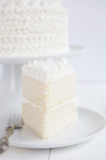 Slice of WASC cake, a semi-homemade white cake recipe.