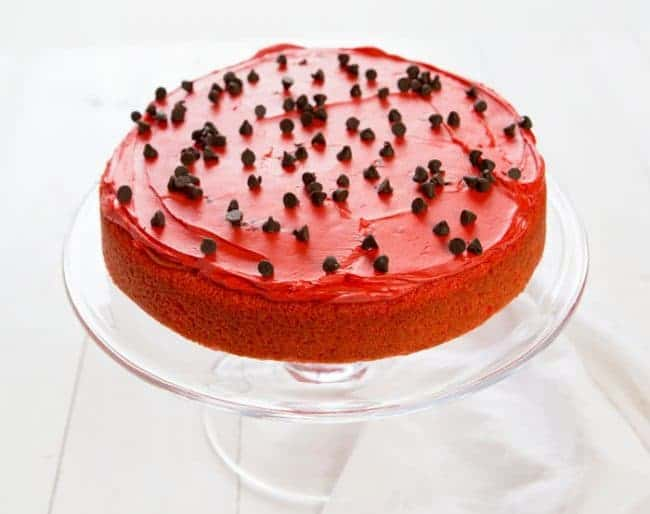 First layer of watermelon cake with frosting and mini chocolate chips!