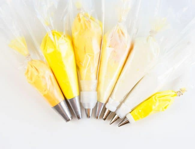 Shades of yellow buttercream ready to be piped on a cake!