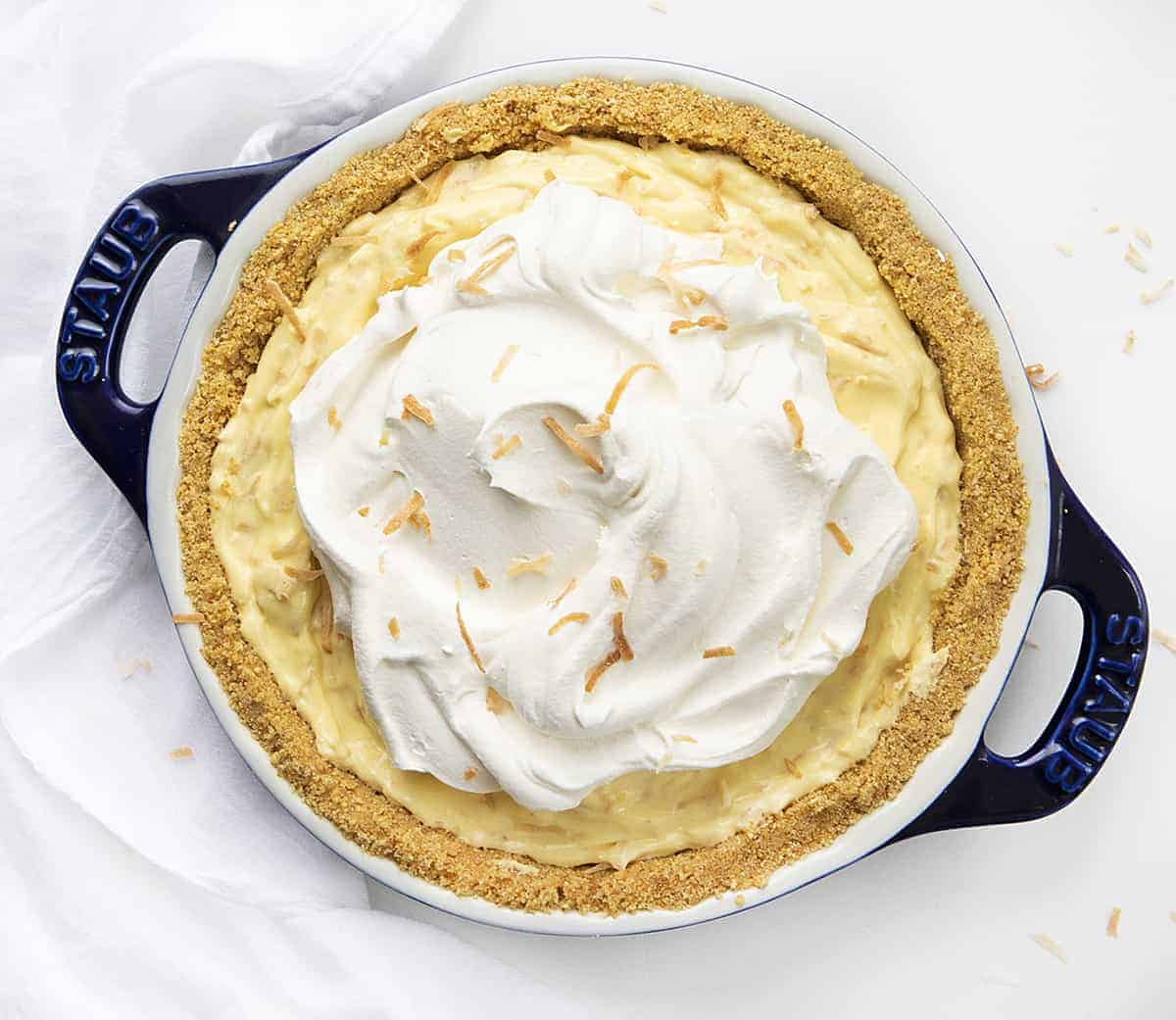 Overhead View of Coconut Cream Pie in Blue Pie Pan on White Counter
