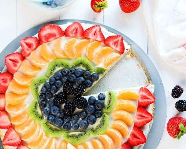 Rainbow fruit pizza with one slice missing... ;)
