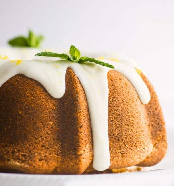Lemon Bundt Cake on Cake Stand with Icing Drizzling