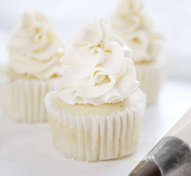 https://iambaker.net/wp-content/uploads/2018/01/coconut-frosting-cupcake-BLOG-650x600.jpg