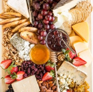 Learn how to build your own delicious Cheese Tray! Pair a variety of cheeses with fruits, nuts, crackers, and spreads for the ultimate appetizer platter.