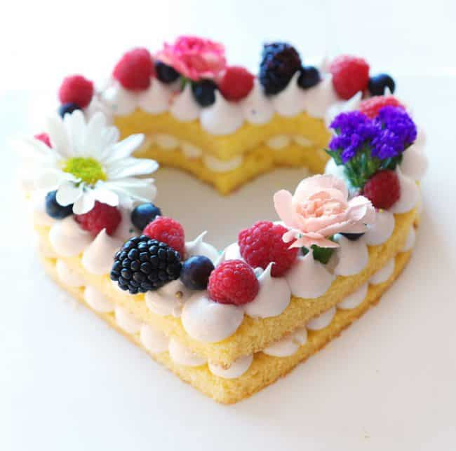 Layers of cake decorated with fruit and flowers!