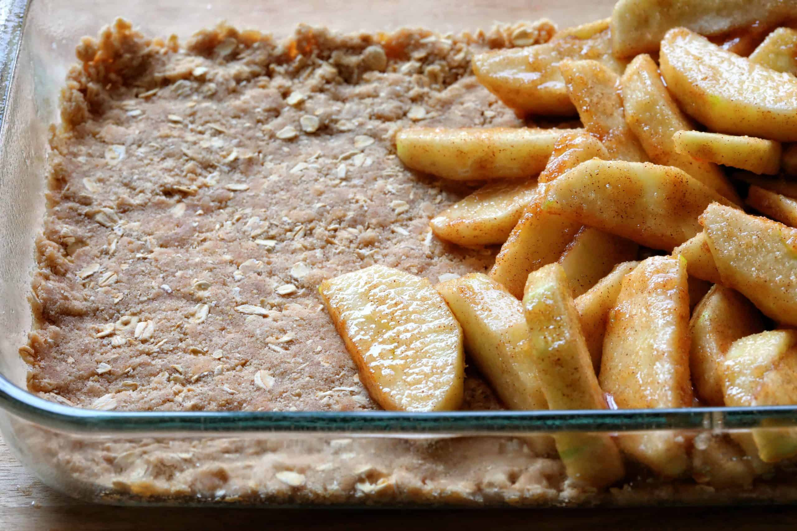 Pan Showing Bottom Layer of Double Crisp Apple Crisp with Apples on Top