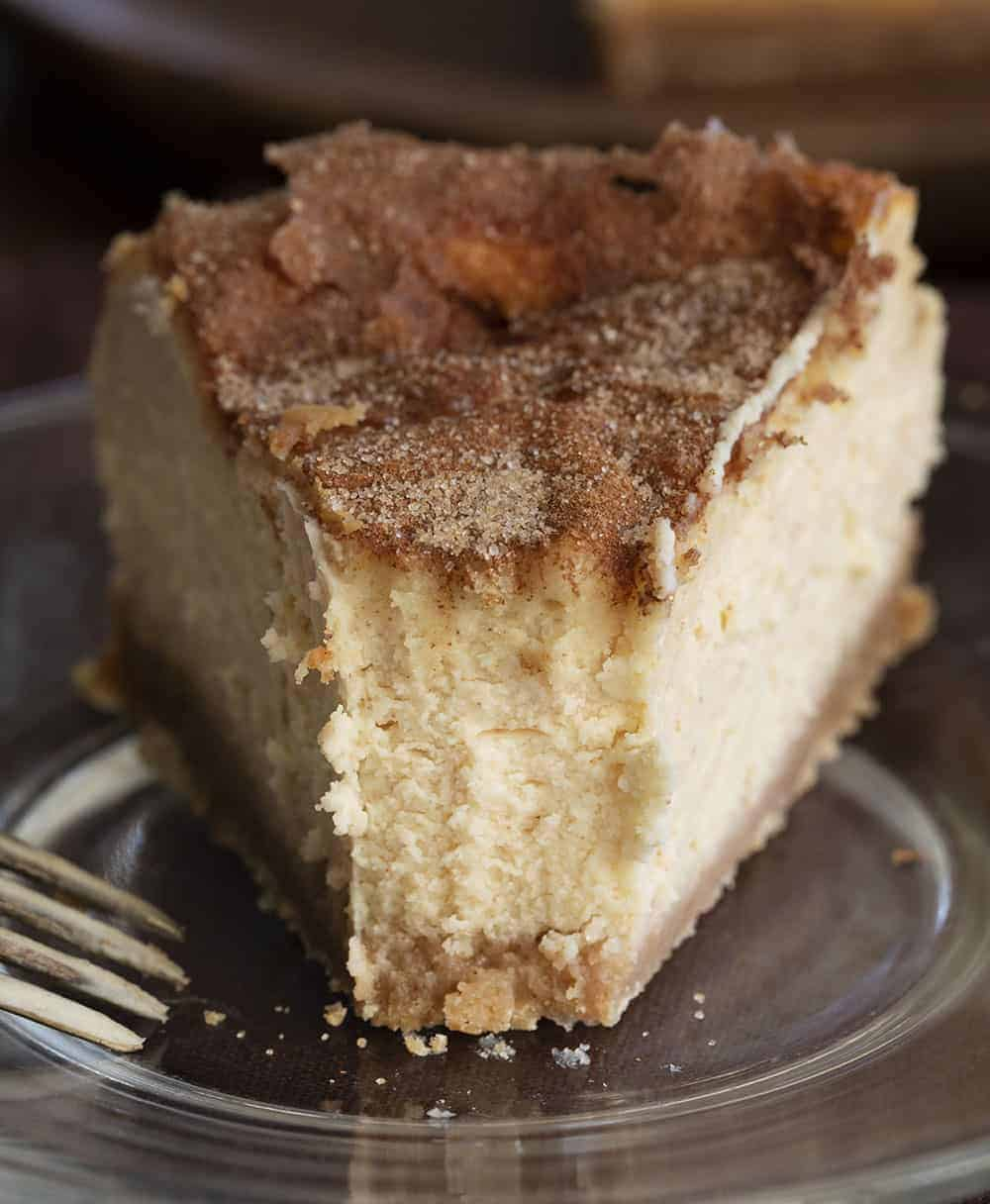 Slice of Snickerdoodle Cheesecake With Bite Missing