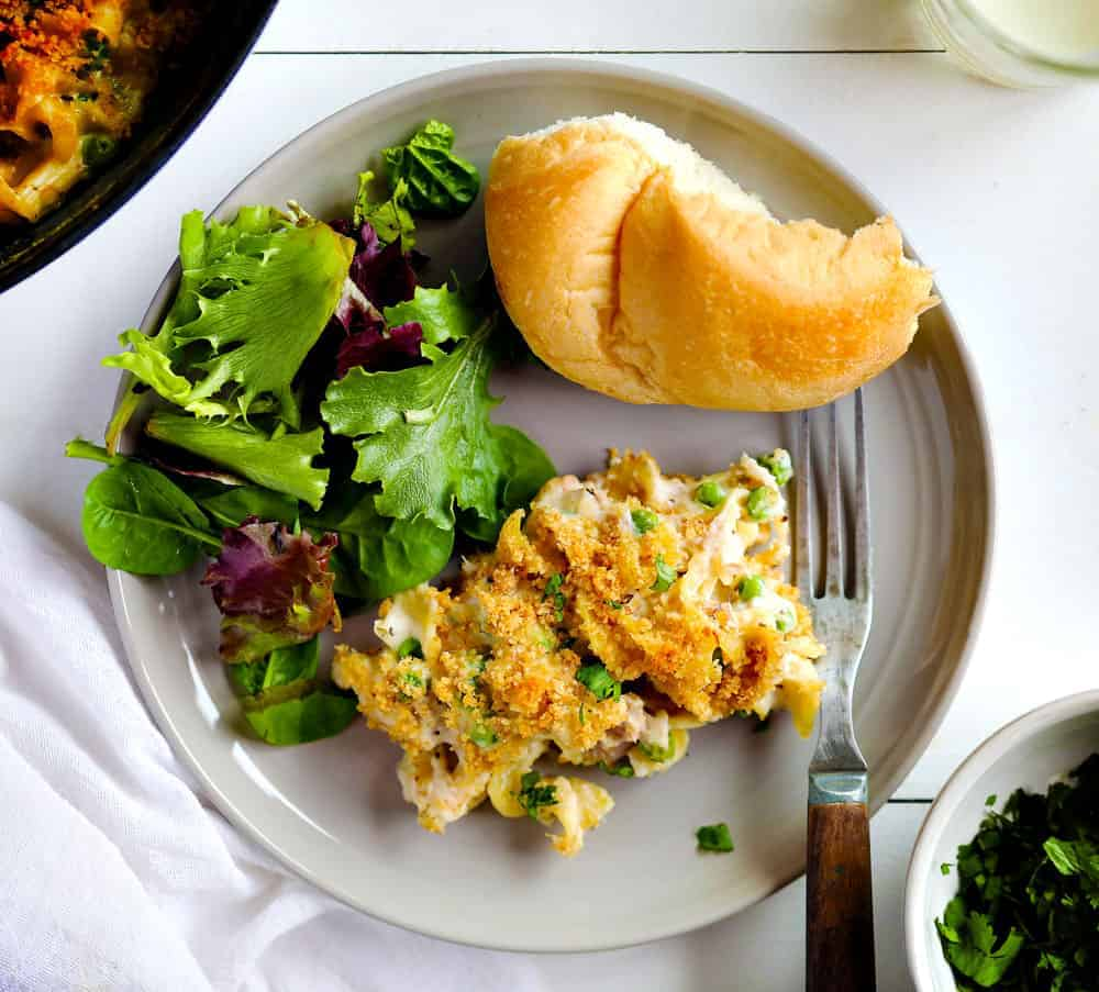 Tuna Casserole on a Plate with Salad and Bread