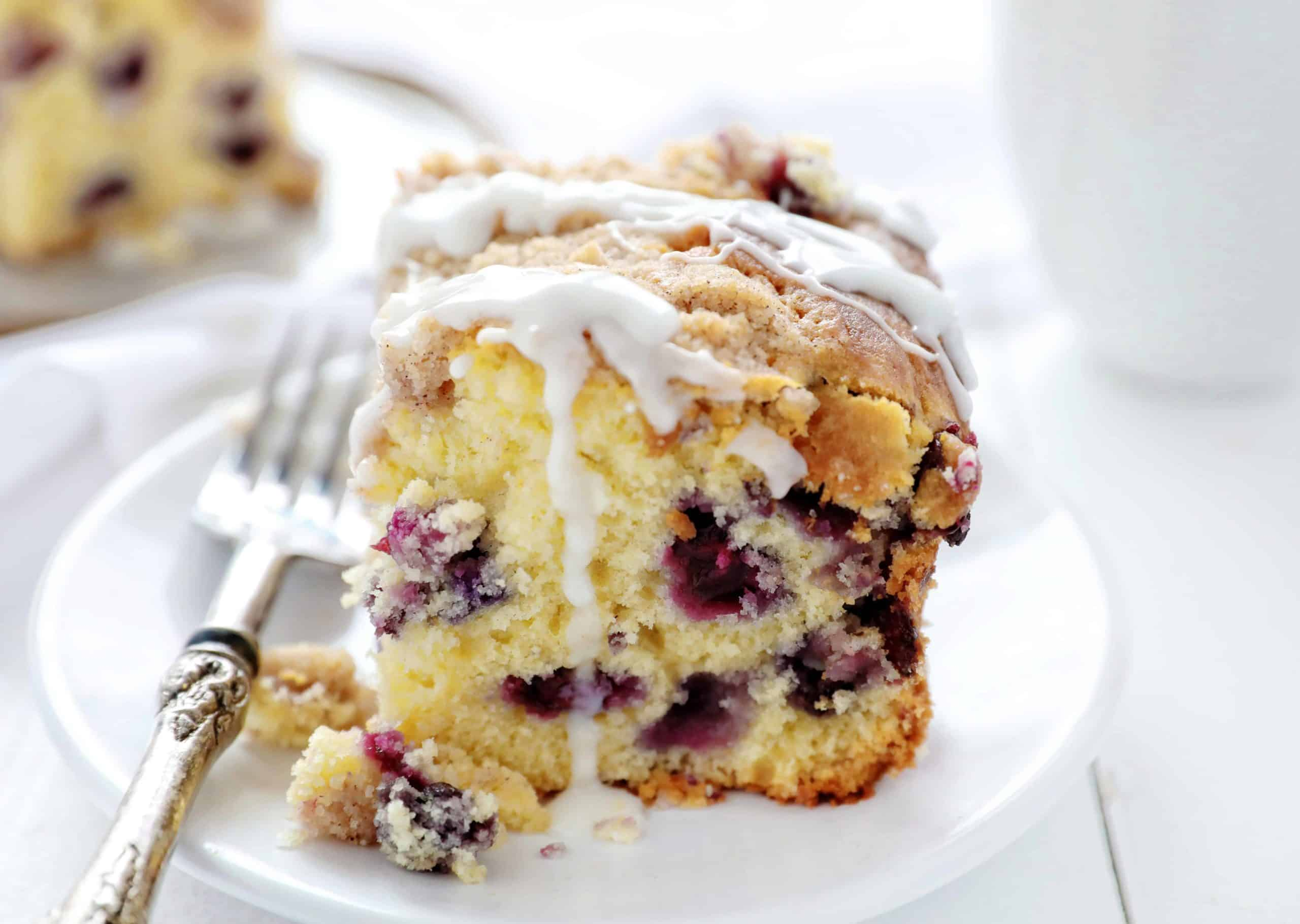 Blueberry Breakfast Cake or Coffee Cake on White Plate with Fork