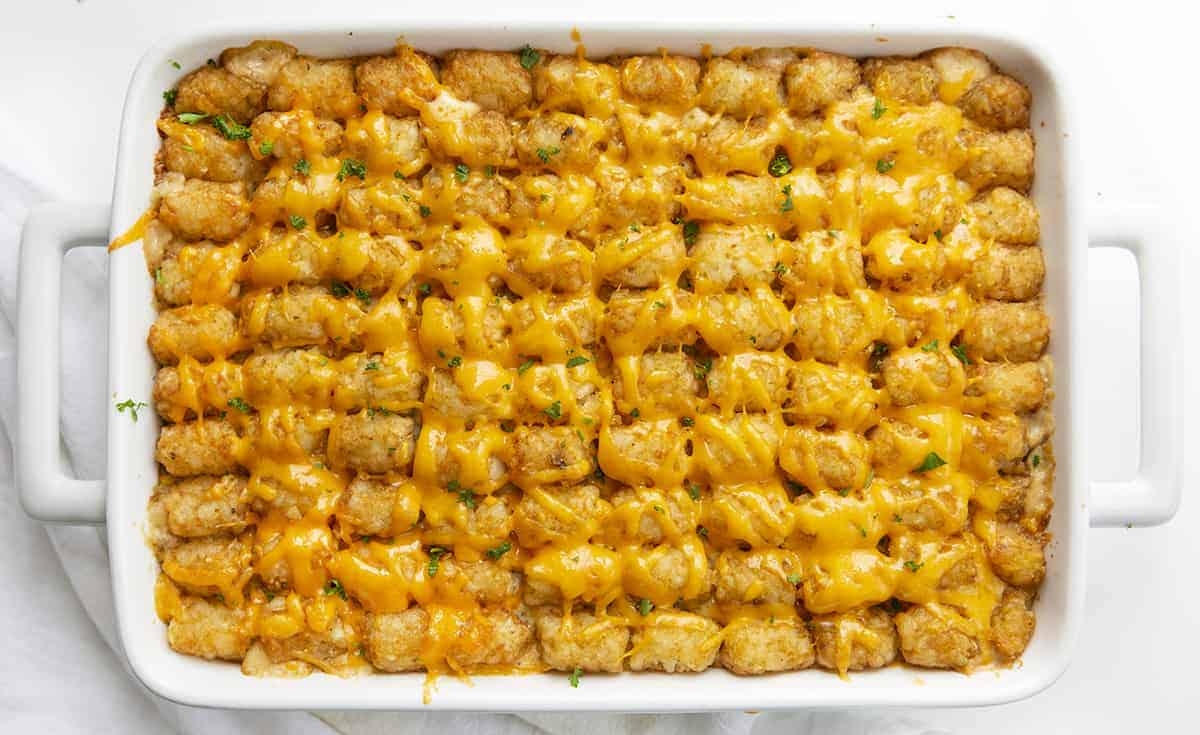 Overhead of Tater Tot Hotdish in White Casserole Pan with White Towel