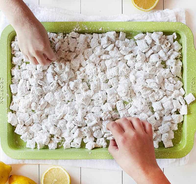 Children's hands Eating Lemon Puppy Chow
