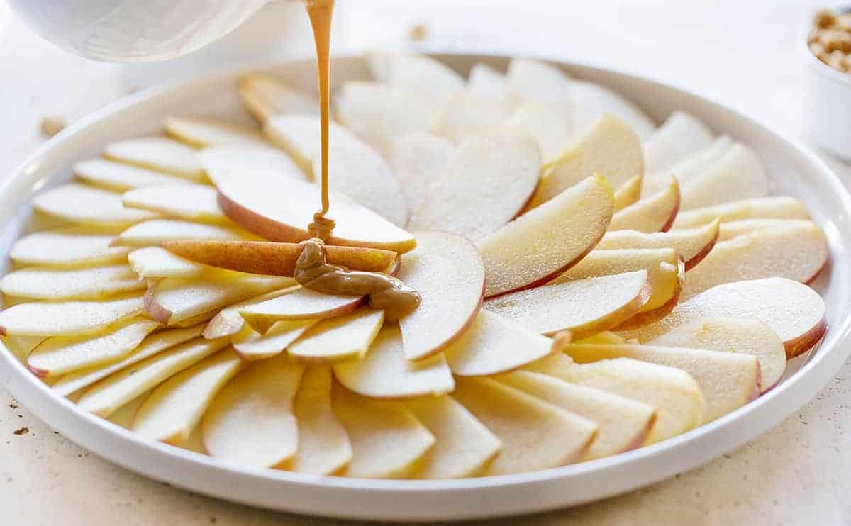 Apples Being Drizzled with Warm Peanut Butter