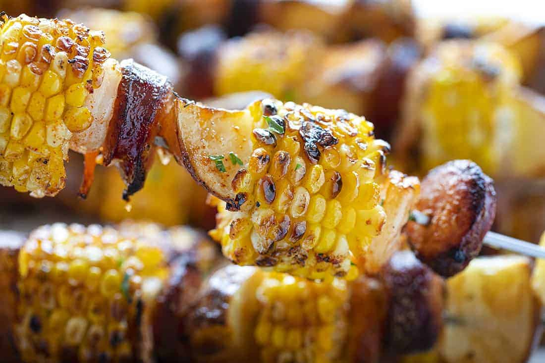 Corn shrimp sausage and potatoes on a skewer