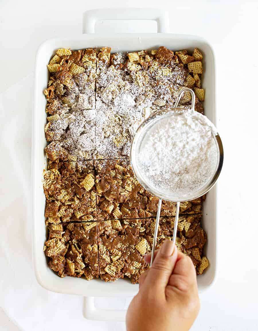 Puppy Chow Bars Sprinkled with Confectioners Sugar