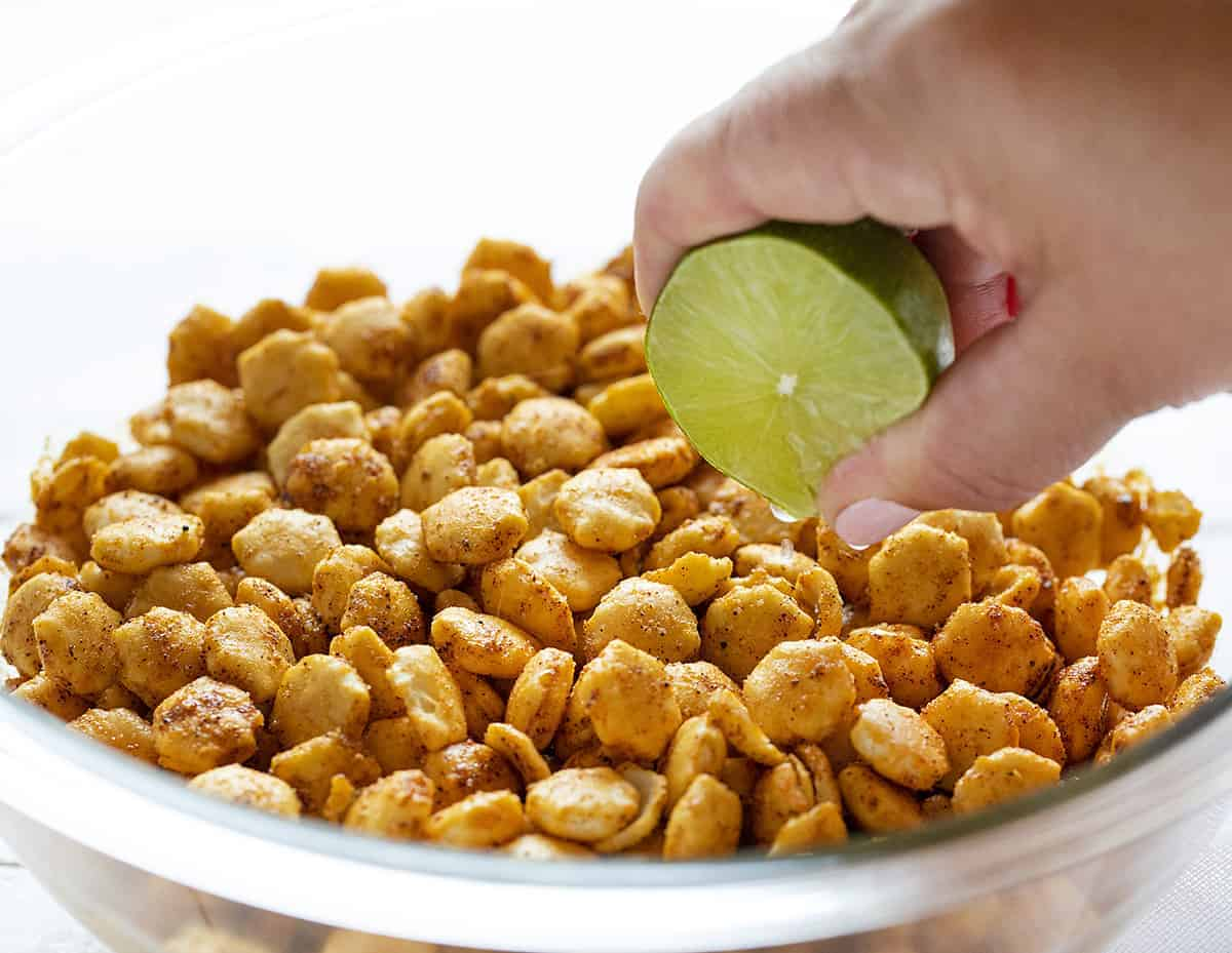 Squeezing Lime Juice on Taco Oyster Crackers
