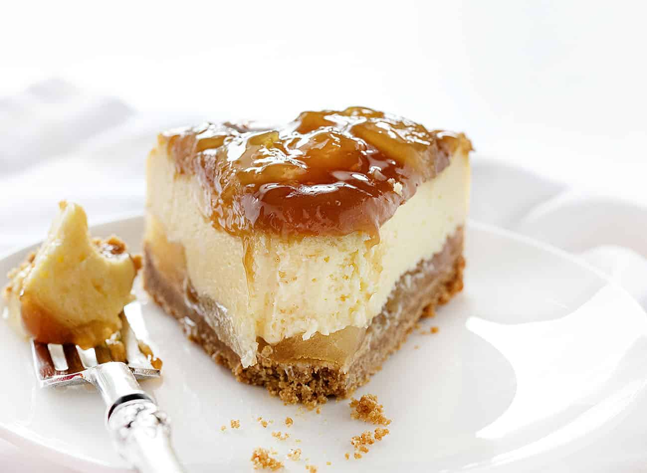 Bite Out of a Slice of Caramel Apple Cheesecake
