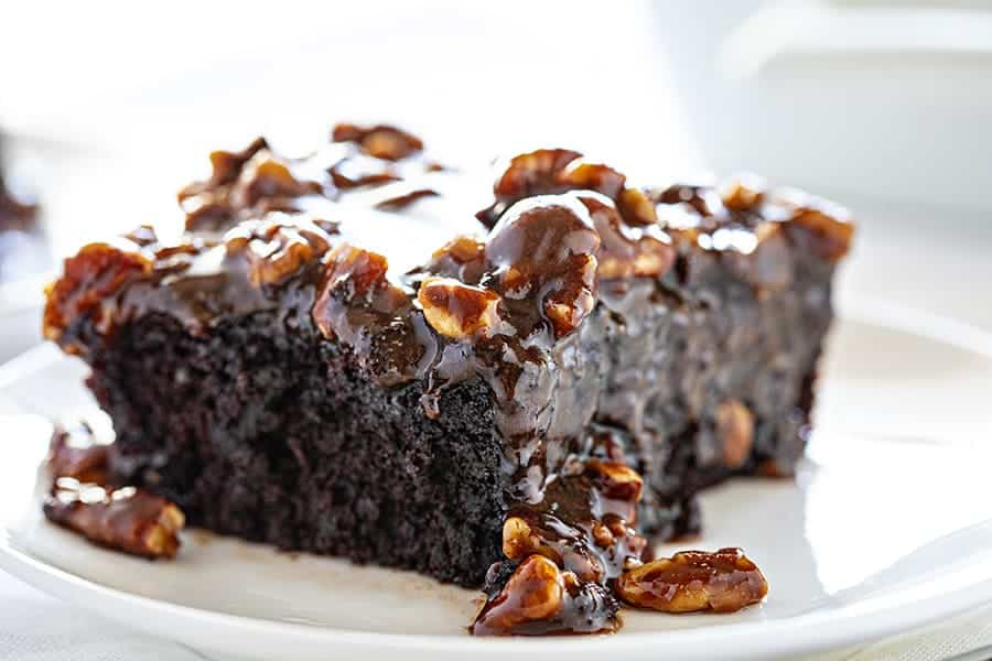 Slice of Dark Chocolate Cake with Buttermilk Pecan Frosting