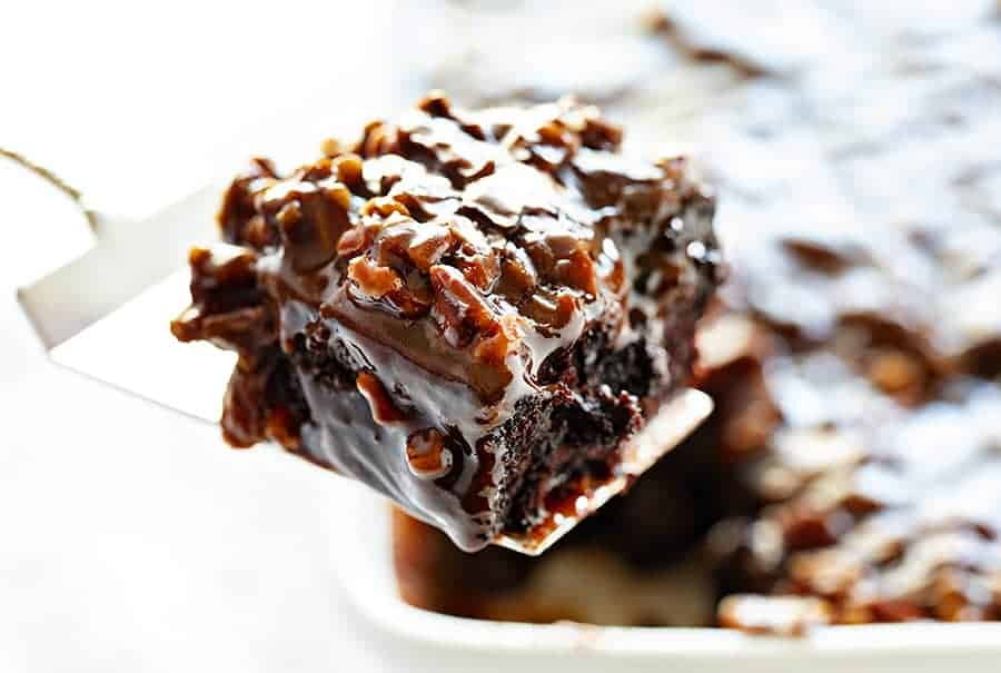 Serving Chocolate Cake with Pecan Frosting
