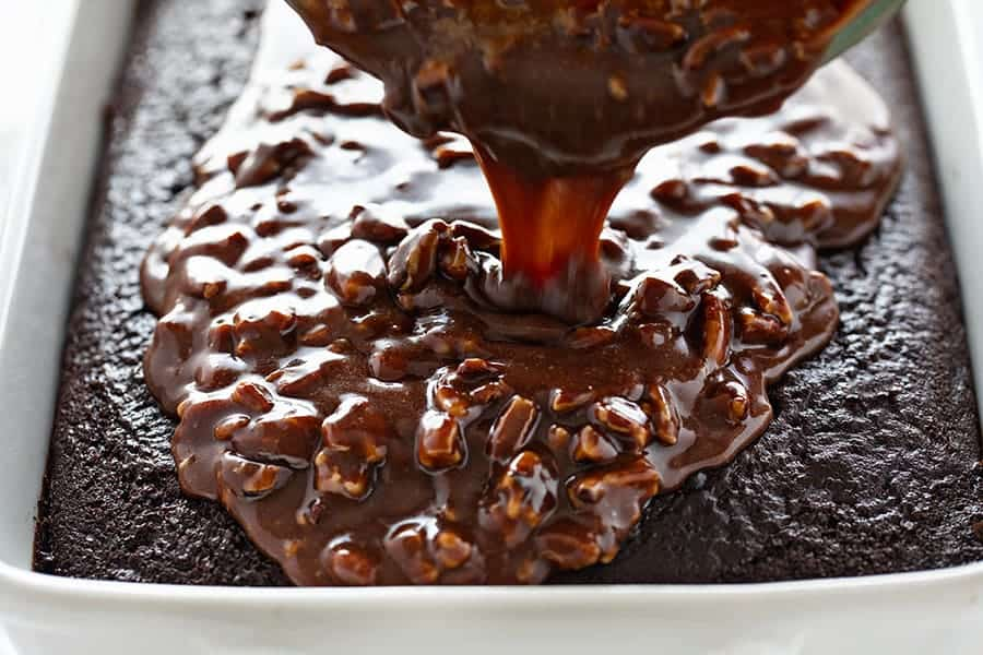Frosting Poured Onto a Chocolate Cake