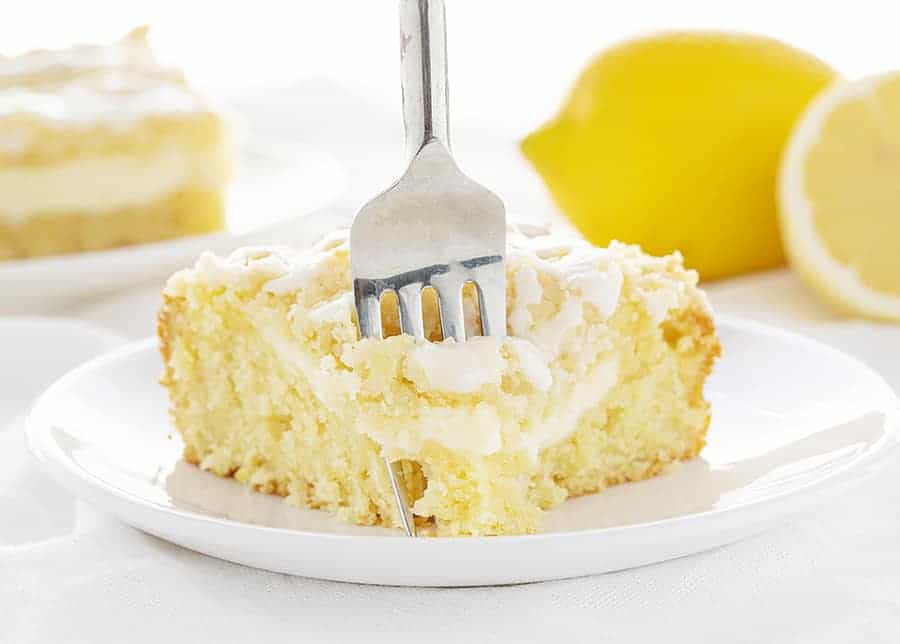 Fork taking a bite of Lemon Coffee Cake