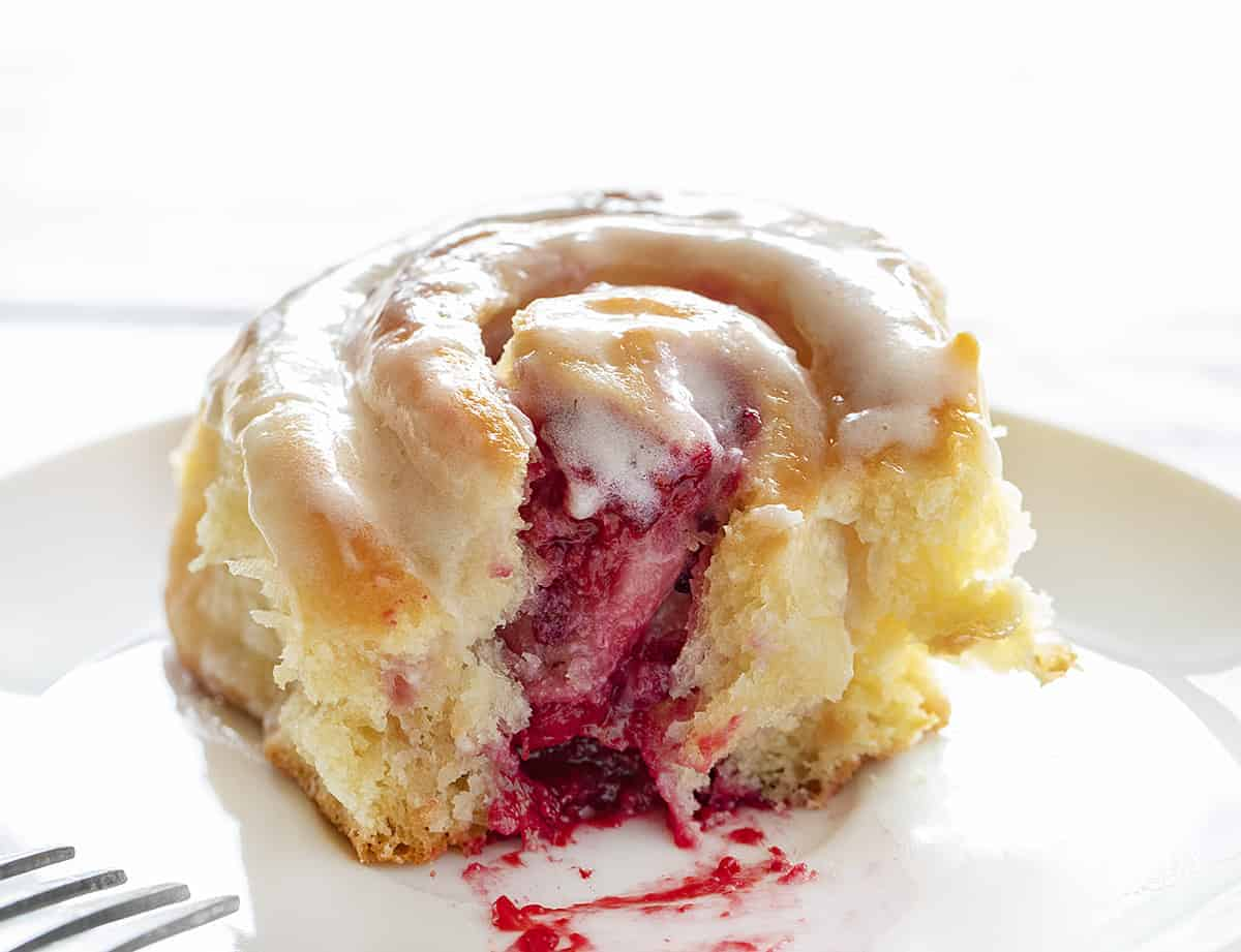 Cut Raspberry Cream Cheese Sweet Roll