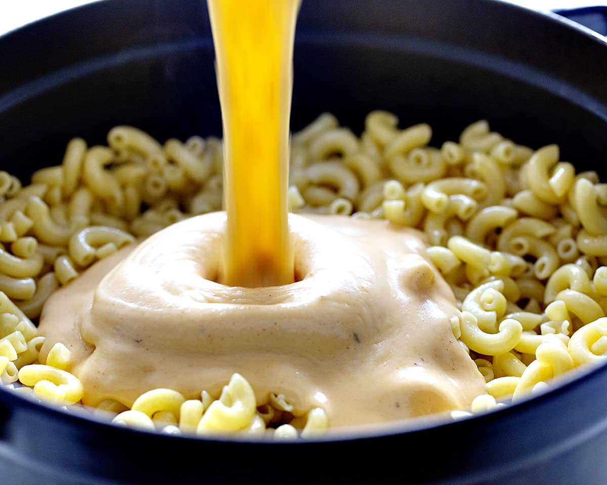 Pouring Cheese into Cajun Chicken Macaroni and Cheese