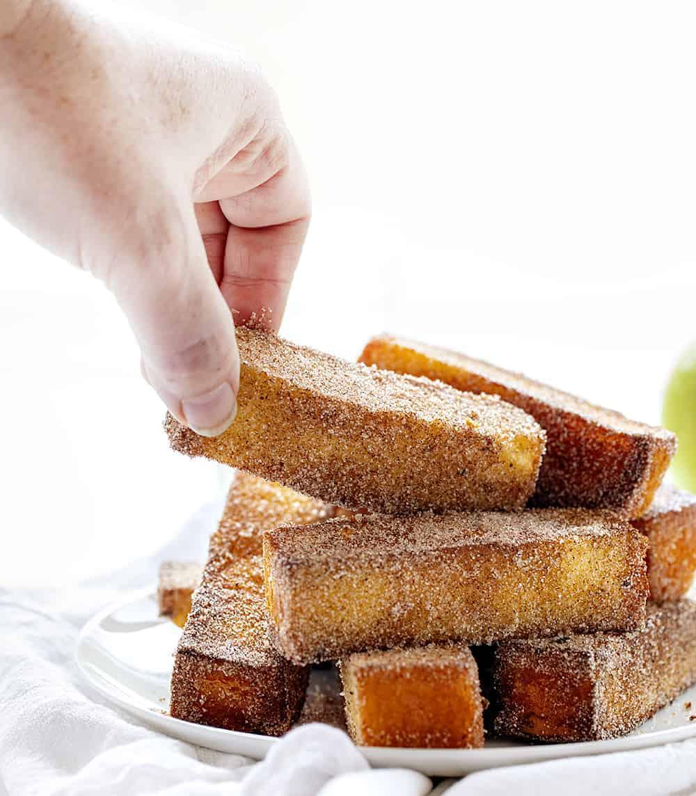 Picking up a Fried Apple Spice Cake Stick