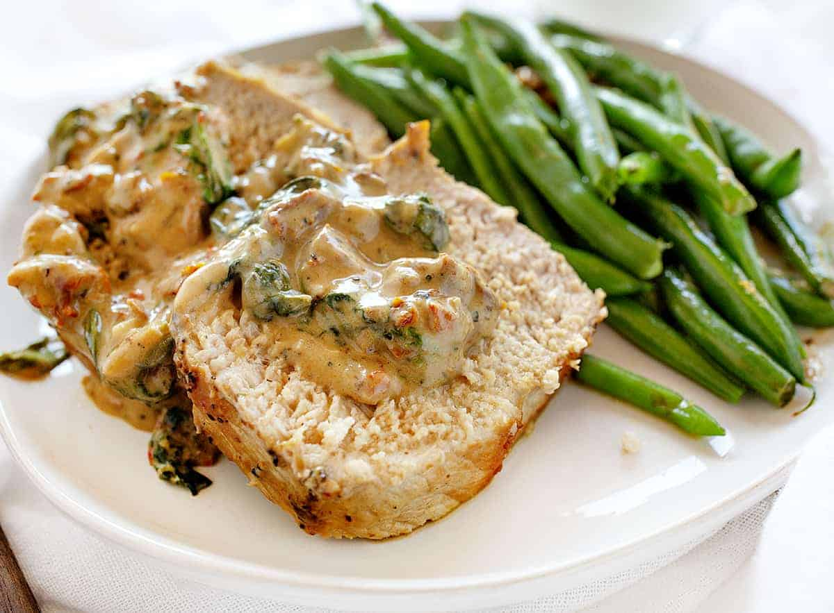 Pork Tenderloin with Parmesan and Roasted Garlic Cream Sauce