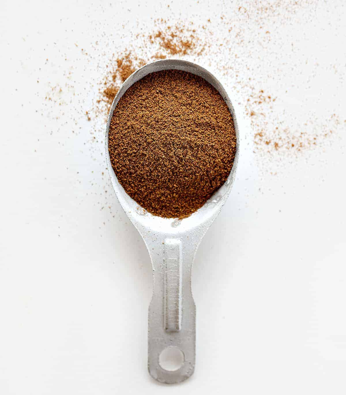 Homemade Pumpkin Pie Spice in a Measuring Spoon