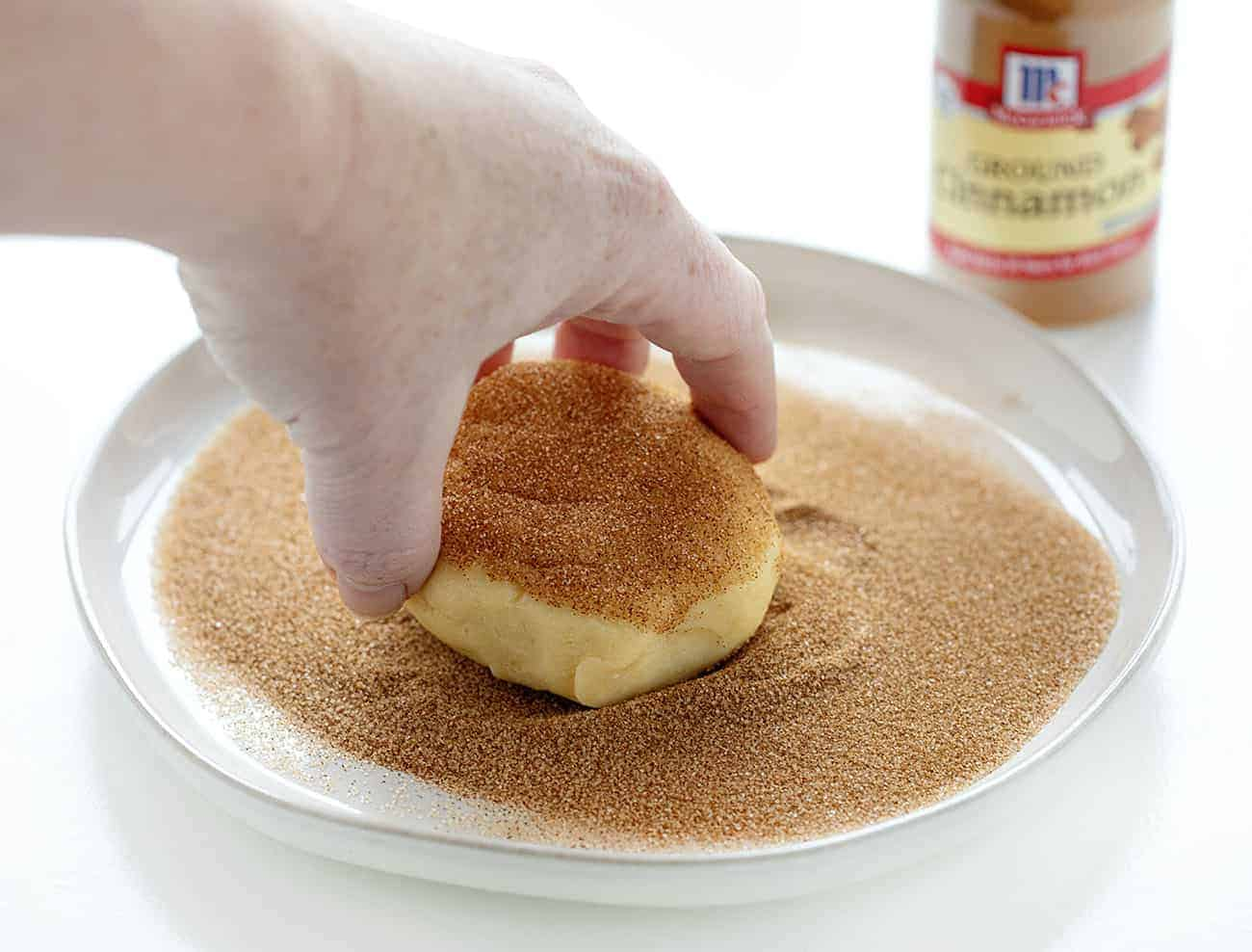 Dropping Snickerdoodle Cookie Dough into Cinnamon and Sugar