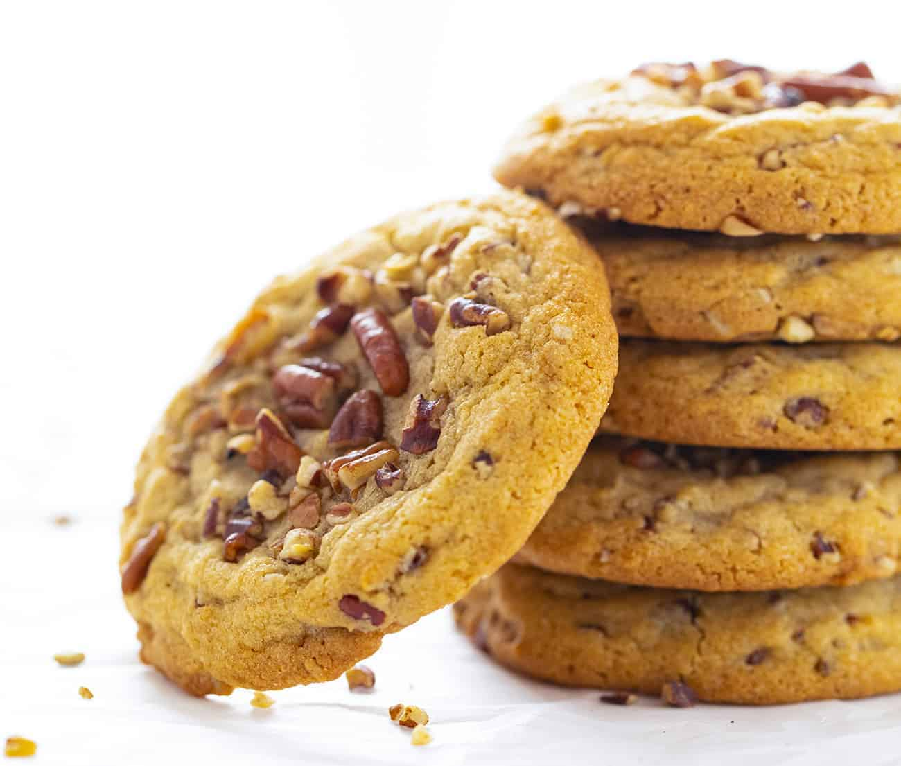 Stack of Butter Pecan Cookies with One Cookie Leaning